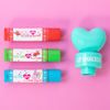 Lip Smacker | 3 Piece Lip Balm with Heart Topper | Product front facing out of tube caps fastenend, with pink background