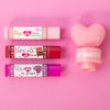 Lip Smacker | 3 Piece Lip Balm with Heart Topper - Pink | Product front facing out of tube caps fastenend, with pink background