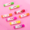 Lip Smacker | My Punny Valentine 8 Piece Lip Balm | Products front facing scattered caps fastenend, with pink background