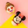 Disney Emoji Lip Balm Duo - Belle & Minnie   Wet n wild   Product front facing angled, with pink and yellow background