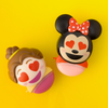 Disney Emoji Lip Balm Duo - Belle & Minnie   Wet n wild   Products back angled caps open, with yellow background