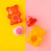 BFF Sugar Bear Lip Balm Duo- Pink & Yellow | Lip Smacker | Product angled, with yellow and pink background