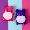 BFF Sugar Bear Lip Balm Duo- Pink & Purple | Lip Smacker | Product front facing cap fastened, with purple, blue and pink background