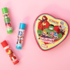 Lip Smacker | Marvel 3 Piece Lip Balm Tin | Product Front facing scattered cap fastened, with pink background