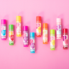 Lip Smacker | You're the Balm 10 Piece Lip Balm | Products front facing scattered caps fastened, with pink background
